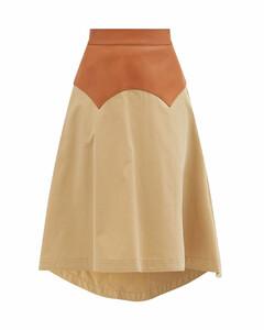 Leather-yoke dipped-hem cotton-gabardine skirt