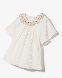 Curved jacket in wool twill with curved shoulders