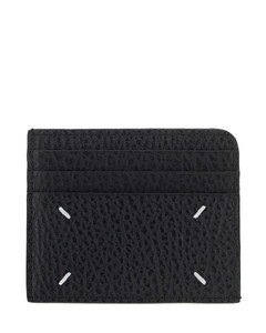 The mini pouch clutch in woven leather