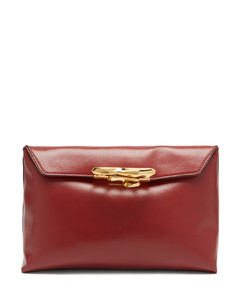 Sculptural four-ring leather clutch