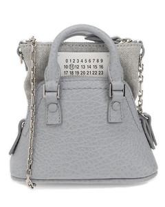 Cage chain-embellished leather shoulder bag