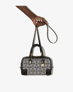 Shoulder bag with metal logo charm