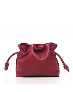 red clutches in nappa calfskin with adjustable and removable strap.