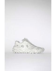 Distressed sneakers