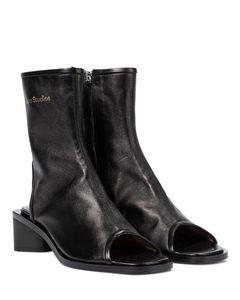 露脚趾皮革及踝靴