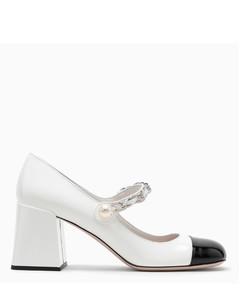White/black patent leather pump