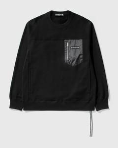 Asymmetrical buttoned overcoat
