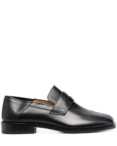 Black leather low-heel tabi loafers from maison margiela featuring branded insole, tabi toe and low block heel.