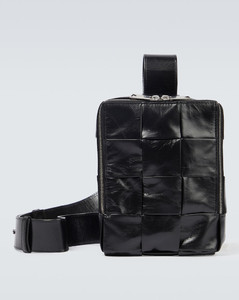 GG-monogram perforated-leather holdall